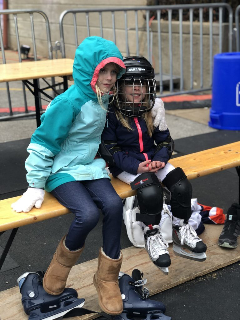 The girls are taking a shift off on the bench